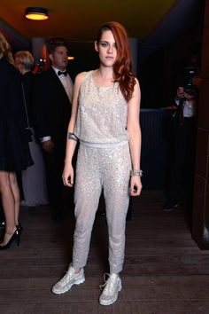 A pair of sparkly white tennis shoes to match her bedazzled couture sweatsuit. Nice choice, Kristen!