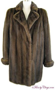 SOLD! Neiman-Marcus Mahogany Mink Jacket; MM771; Excellent Condition; Size range: 10 - 14. This is a stunning genuine natural mahogany mink fur jacket. It has a Neiman-Marcus label and features a notched collar, turn-back cuffs and built-in shoulder pads.  This is a very high quality mahogany mink jacket that may be worn both casually as well as to more dressy events. fursbychrys.com