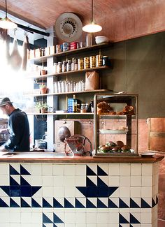 Half-square tiles used to create a quirky, meaningful pattern. And the copper countertops and backsplash - just lovely. --- Steal the Style: 10 Restaurant Interiors to Inspire Your Kitchen Renovation Café Restaurant, Restaurant Design, Restaurant Interiors, Cafe Design, Küchen Design, Commercial Design, Commercial Interiors, Wc Container, Café Bistro