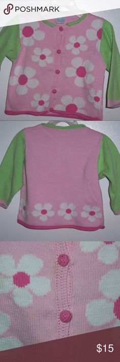 """Little Girls Pink Floral Sweater Cardigan Small Little girls button down sweater cardigan  Chez Ami brand  Size small Pink & white flower pattern  Green trim at neckline &  green sleeves  Pretty crochet detail down the front center where it buttons  Tiny pink buttons are covered in crochet as well Size tag is in rough shape , but this in no way affects the wear or intended use of this sweet sweater  Measures about 15"""" long back of neck to hemline  Sleeves measure about 11"""" long   Measures…"""