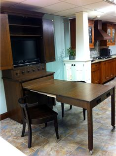 Schilling - Wood-Mode hutch cabinet after table pullout