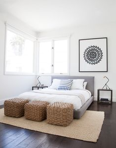 Use art to add balance to an off center window in a bedroom.