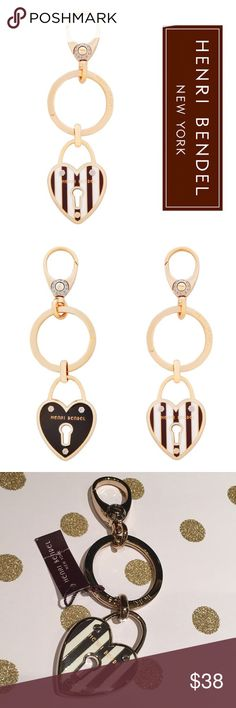 """Henri Bendel Heart KeyChain Brand new with tags Henri Bendel Key chain 12K Gold plated brass Enamel coating Signature Brown & White Stripes Rivet details Dimensions: 1.75""""L charms; 4.5""""L total . Reasonable offers considered through offer button only NO TRADES henri bendel Accessories Key & Card Holders"""