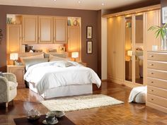 Romantic Couples Bedroom with the Beautiful and Interesting Design : Awesome Modern Couples Bedroom Wooden Wardrobe Laminate Flooring And White Spring Bed