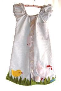 Refashioned men's dress shirt into a girl's dress.  Along the border of this dress is a chick and a rooster.