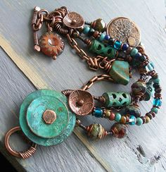 Old Verdigris Coin Bracelet in Turquoise and Southwest Colors with British Copper Coin Charm by lunedesigns, via Etsy.