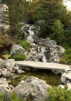 The stone footbridge fits perfectly in this traditional landscape