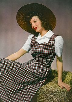 I adore Loretta Young's jumper dress ensemble and wide-brimmed straw hat here. #vintage #1940s #fashion #actresses #farm_girl_chic