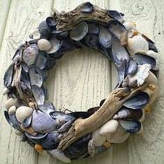 I know this is a wreath made of clam or mussel shells, but they look blue-gray and combined withn the drifwood, it's beautiful!