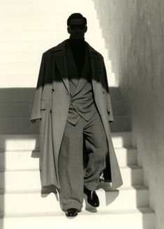 Mystery man emerging from the shadows (but staying well within his trenchcoat)