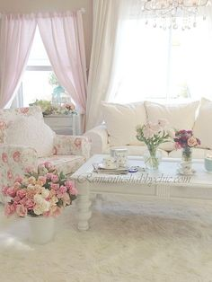Chair slipcover with old-fashioned rose pattern and beautiful roses in the room.
