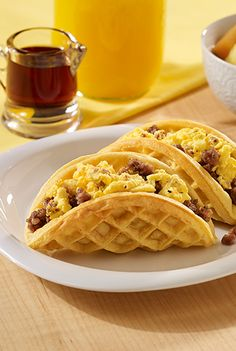 A breakfast for dinner recipe with buttermilk waffles filled with crumbled sausage and Egg Beaters to be eaten like a taco