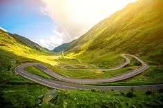 The Transfăgărășan Highway is one of the best motorbike roads in Europe and is at least the most dramatic road in Romania. Road Trip Europe, Road Trips, Beautiful Roads, Europe Destinations, Travel List, Summer Travel, Drum, Adventure Travel, Bali