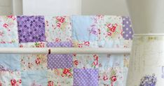 This little quilt in soft and pretty rose and lavender fabrics is finally finished and hanging in my studio for a few days for me to enj...
