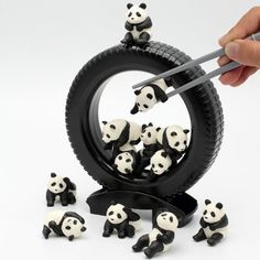 """Panda Darake is an addictive game of balance played with Asia's most famous bear and a pair of chopsticks. """"Darake"""" means """"chockerblock"""" or completely full, and in this variation on Jenga there are certainly more of the bears than you normally find at the zoo! In fact, there are twelve cute pandas in this set - but what do you do with them?Well, there are several different games to play here, such as seeing who can transfer the pandas into the inside of the tire without dropping them. Or you…"""