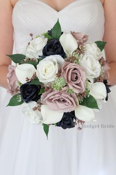 This is a stunning round bouquet in navy blue, white, dusty rose, and rose gold all of our flowers are made with artificial flowers and will last forever Dusty Rose Wedding, Blue Wedding Flowers, Gold Wedding, Bridesmaid Dress Colors, Bride Bouquets, Davids Bridal, Rose Petals, Babies Breath, Calla Lilies