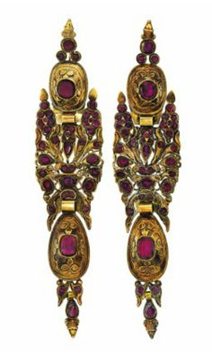 A pair of rare late 18th century Catalan gold and garnet pendent earrings  Each navette-shaped ear pendant composed of four articulated sections set throughout with vari-shaped foiled garnets, the mounts with raised repoussé style decoration and foliate engraved decoration to the reverse, circa 1780, 15.5cm long