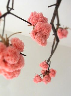 Great idea...pom poms made to look like flowers. buy from the pom pom factory