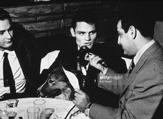 American jazz trumpeter and singer Chet Baker (1929 - 1988) is interviewed by a man with a microphone, whilst sitting with a collie, 13th December 1954.