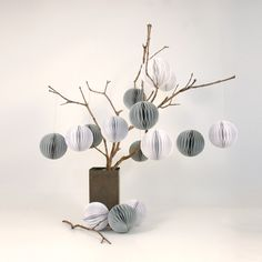 Duck egg blue and white baubles on a simple twig tree