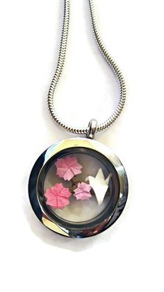 Origami Cherry Blossoms and a Paper Crane on natural tree branch captured inside stainless steel floating locket and attached to 2mm snake style, precious metal sterling silver chain. Take a closer look at how tiny the cherry blossoms and the origami crane are.