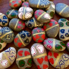 Domino game made of 28 hand-painted and varnished pebbles, featuring all 6 different patterns. Wood box painted in gold, with coloured font.