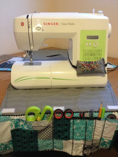 Sewing machine cover with built in organizer when open. The pin cushion is great as well