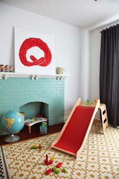 """Depending on how the living room comes together, it may be fun to paint the fireplace a crazy color…the brick is already fully painted now….I could always change it back to a """"normal"""" color later."""