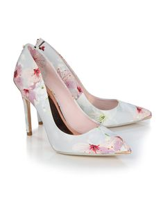 7379ce610 The Kawaap heeled court shoes from Ted Baker are a feminine summer style  which features this seasons Oriental Blossom print. With a metallic bow  stud at the ...