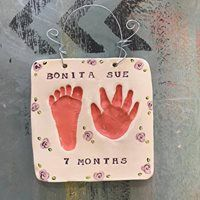 Pretty little peach hand and foot print impressions in clay with hand painted lavender flowers. Baby Hand And Foot Prints, Hand Prints, Little Peach, Baby Hands, Pottery Studio, Lavender Flowers, Footprint, Pretty Little, Clay