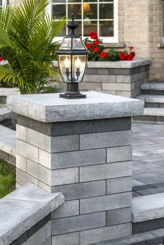 Front entrance using Unilock Lineo Dimensional Stone pillar, with universal coping Front Courtyard, Front Walkway Landscaping, Front Garden, Patio Design, Outdoor Stairs, Front Patio, Front Yard, Outdoor Post Lights