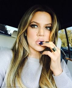 Newly single Khloe Kardashian is pretty in pastels at womens event #dailymail