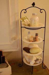 Vertical serving plates shouldn't just be used for when you host parties...allow them double duty to organize bath items for guests in guest bathrooms.