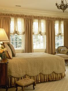 Love the way the scalloped coverlet mirrors the balloon shades. rod pocket drapery side panels with sheer balloon shades