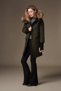 KERRIANE-R is a mid-length, relaxed fit wool parka, with removable fur trim on the oversize face-framing hood. The high-low hem and dropped shoulder create a comfortable, contemporary look. Sherpa lined collar, elongated ribbed cuffs with thumbholes, and a quilted lining provide extra warmth. Discover at http://www.soiakyo.com/ca/en/kerriane-r-wool-parka-with-removable-fur-hood-trim-in-moss-for-women