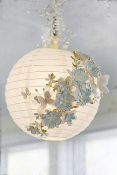 Paper Lantern & Paper Butterflies.    IDEA! -- Use a sponge to distribute glow-in-the-dark paint over the inside/outside of paper lanterns so they'll look lit up.