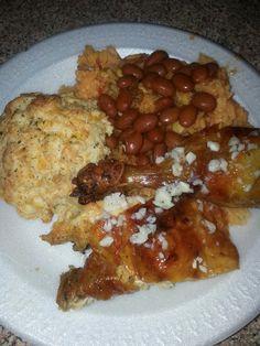Rotisserie chicken w/garlic sauce w/yellow rice and red beans