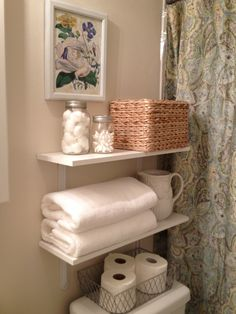 Simplistic White Open Shelves Over Toilet Storage For Towel Place And Tissue Storage Also Cool Grey Floral Shower Curtain In Cream Bathroom Designs