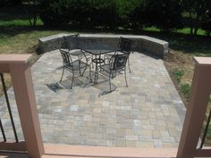 Paver patio off deck with sitting wall-- step down patio off of deck! with pavers