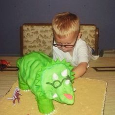 My mom makes some amazing cakes and doesn't keep a log of them so I'm going to start a pinterest album of the sweet confections I snapped pictures of. In this pic my nephew asked for a dinosaur cake with glasses like him :)