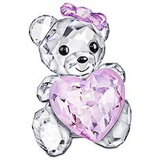 This adorable Kris Bear is the perfect way to say I love you! Holding a heart in Light Rose crystal, she smiles affectionately with her printed mouth. The Light Rose crystal bow adds a cute finishing touch to this heart-warming design. Ideal for Valentine's Day or anniversaries!