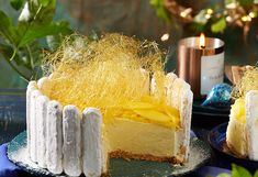 Add coconut to the biscuit base and mango to the filling for a tropical twist, then top with spun sugar to make this cheesecake truly amazing! Milk Tart, Mango Cheesecake, Mango Puree, Cooking Oil, Cheesecakes, Whipped Cream, Tarts, A Food, Food Processor Recipes