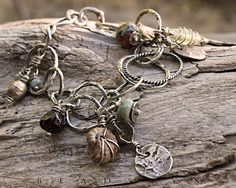 Ancient Glass Ammonite Fossil Charm Bracelet with by Beadstyx