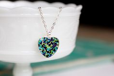 Use sprinkles to create this beautiful (and shockingly easy) pendant in this craft from Simply Create.