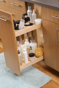 Dura Supreme Bathroom Vanity Cabinetry - A vanity grooming rack is a must-have for curling iron and blow-dryer storage.