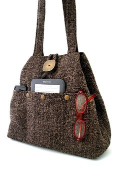 This handmade handbag ,shoulder bag ,can be worn as hobo shape or as tote bag . you can use it as diaper bag, laptop bag , great everyday bag . day to evening bag ,made in USA view more handbags by daphne bags @ http://www.etsy.com/shop/daphnenen  You can change the shape of the bag in seconds by simply tying or untying the metal lobster hook. (See picture)  the bag Made from a HIGH QUALITY ITALIAN BLACK and BROWN decor fabric .  -Handmade to be extremely strong and durabl...