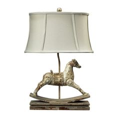 Rocking horse lamp with oval shade.