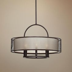 Metal cage detailing creates an intriguing, industrial-inspired look for this transitional 6-light pendant light.