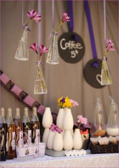 Love the idea of using ribbon to hang vases for decoration...