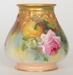 A Royal Worcester 'Hadleys Roses' squat vase raised to three scroll feet, each facia with handpainted roses with low relief gilt borders, green printed marks, height 8cm, restored